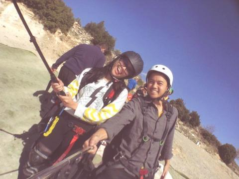 Image of author and her partner taking a selfie before paragliding.