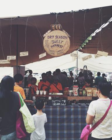 Image of a booth selling organic produce.