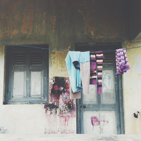 Image of hanged clothing in front of one of the houses.